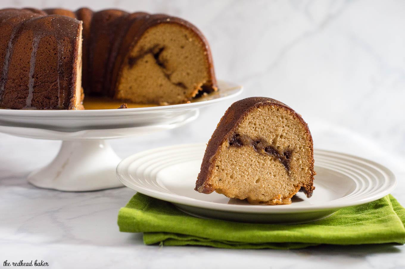 Apple butter pound cake has delicious apple flavor with hints of cinnamon, a ripple of apple butter, and a creamy caramel glaze.