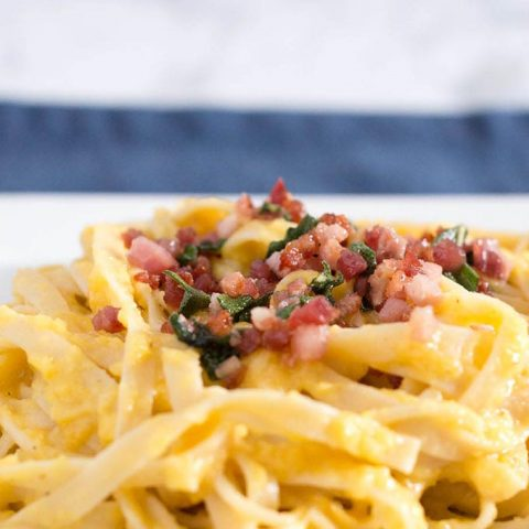 Not a true pasta carbonara, this dish uses pureed butternut squash instead of egg to thicken the sauce that coats the fettuccine.