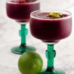 Frozen cherry margaritas are a fun twist on a classic cocktail. Using frozen cherries means you can enjoy this treat any time of the year!