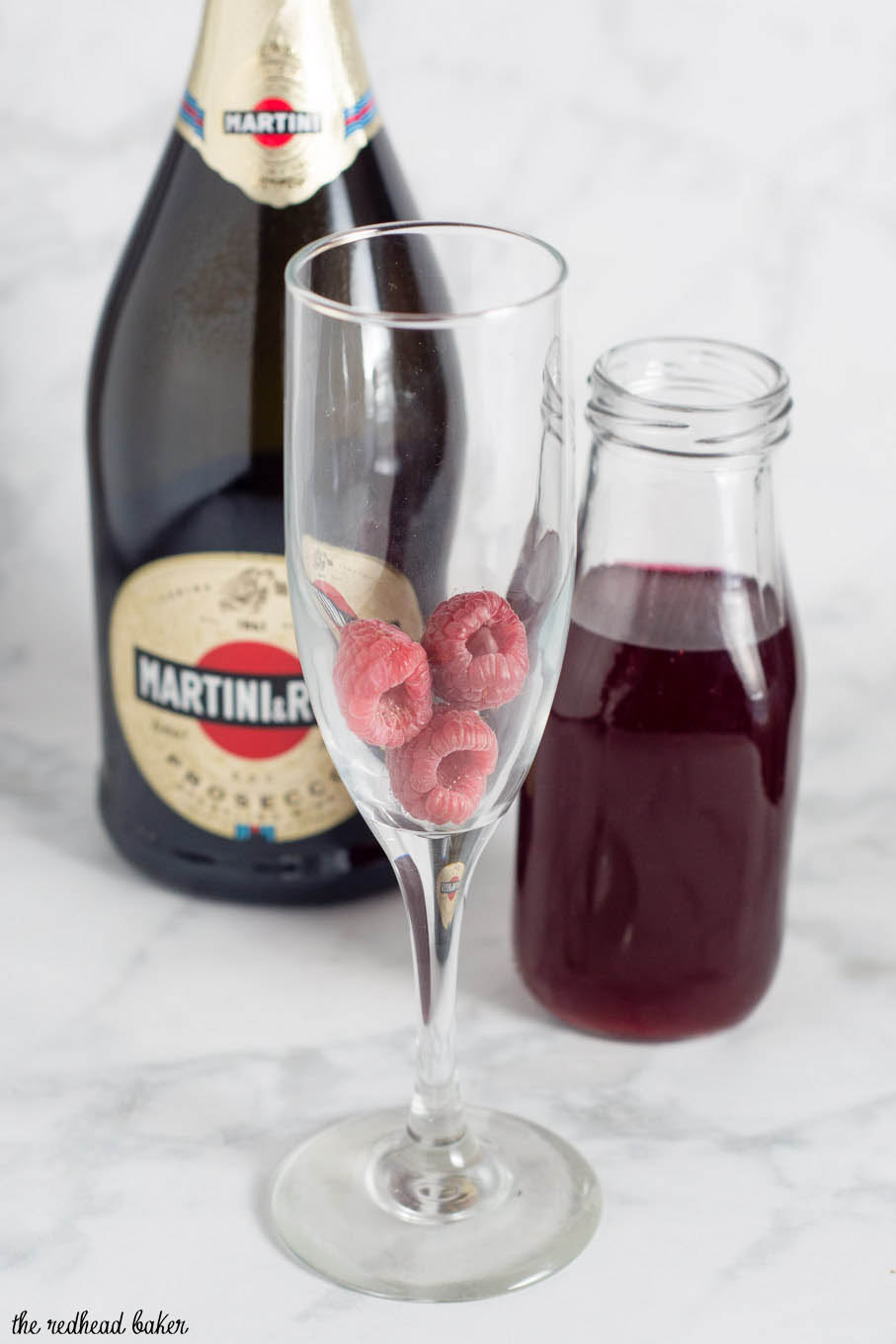 A raspberry bellini combines prosecco with sweetened berry-infused vodka, which gives the cocktail its beautiful pink hue.
