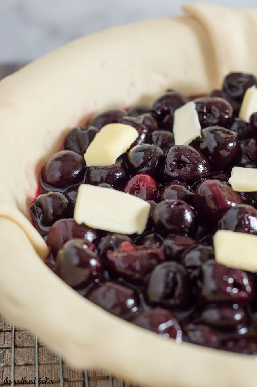 We're celebrating Pi{e} Day! Drunken cherry vanilla pie combines cherries, vanilla bean, and brandy in a flaky pie crust.