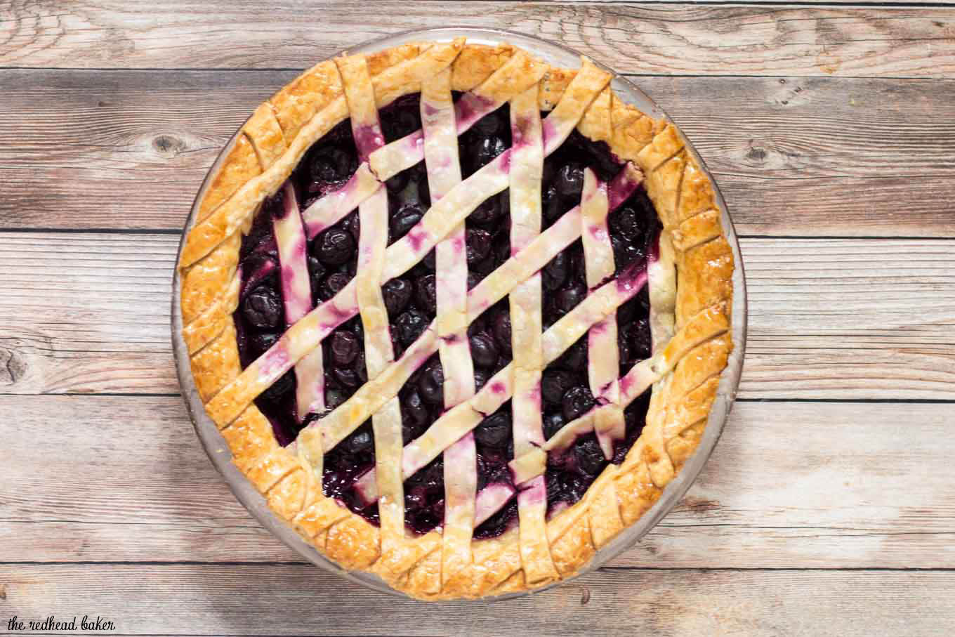 We're celebrating Pi{e} Day! Drunken cherry vanilla pie combines cherries, vanilla bean, and brandy in a flaky pie crust.