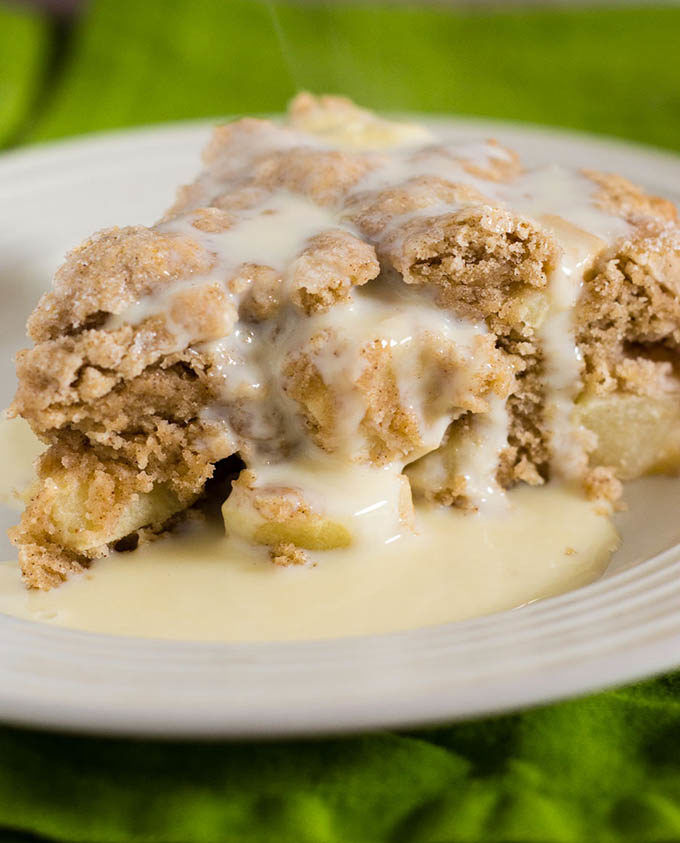 Irish apple cake has a scone-like texture and is studded with chopped apples. Serve with vanilla sauce for a delicious dessert.