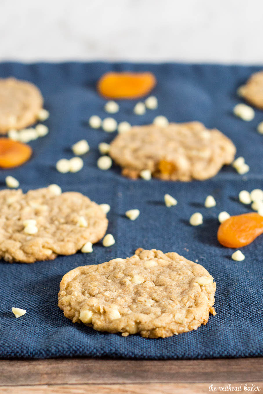 White chocolate apricot oatmeal cookies are crisp at the edges and tender in the middle, and loaded with delicious white chocolate chips and dried apricot pieces.
