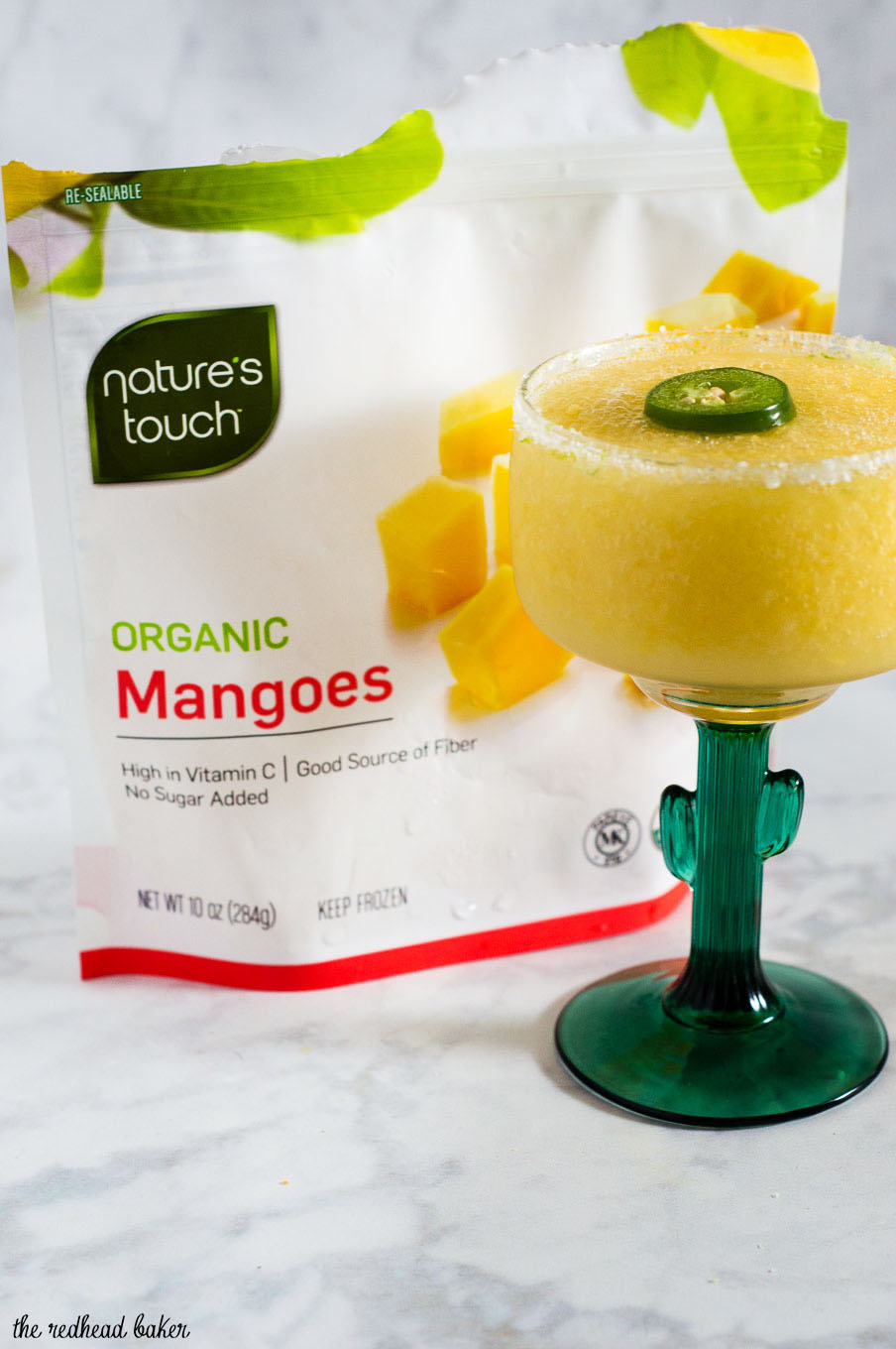 Get a Taste of Adventure with frozen mango jalapeno margaritas! Blend Nature's Touch organic mango with jalapeno-infused tequila, triple sec and lime juice. #FlavorAdventure #ad