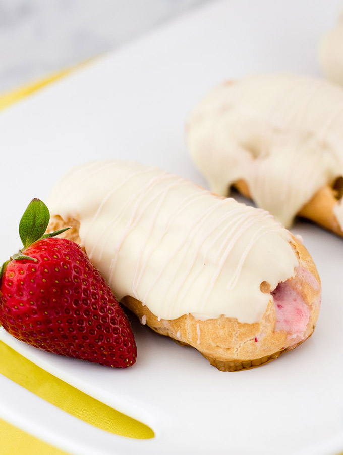 Hop into spring with strawberry-lemon eclairs, filled with fruit-flavored pastry cream then dipped in white chocolate ganache. #ad