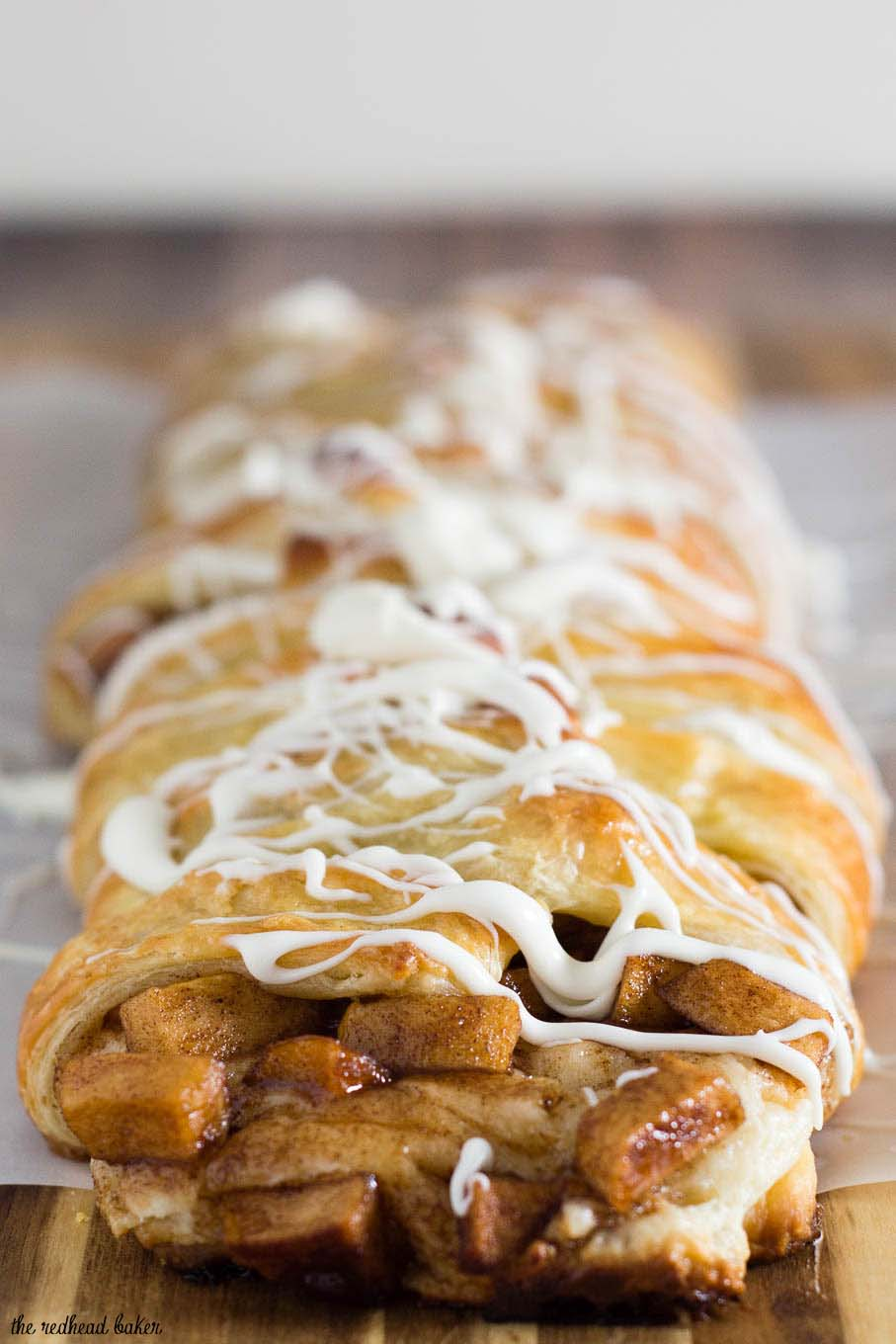 An apple Danish braid is a delicious fruit-filled pastry to serve at brunch. Flaky pastry covers sauteed cinnamon apples and sweetened cream cheese. #BrunchWeek