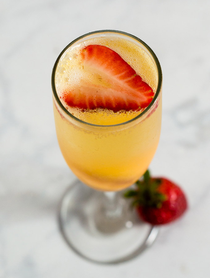 Mango sorbet bellinis are made with just two ingredients, but using sorbet makes them just a little extra special. Top off with a fresh strawberry slice. #BrunchWeek