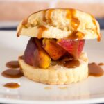 Like the classic strawberry version, peach shortcake combines a sweet biscuit with brandied brown-sugar peaches, and is topped off with a drizzle of salted caramel sauce. #CookoutWeek