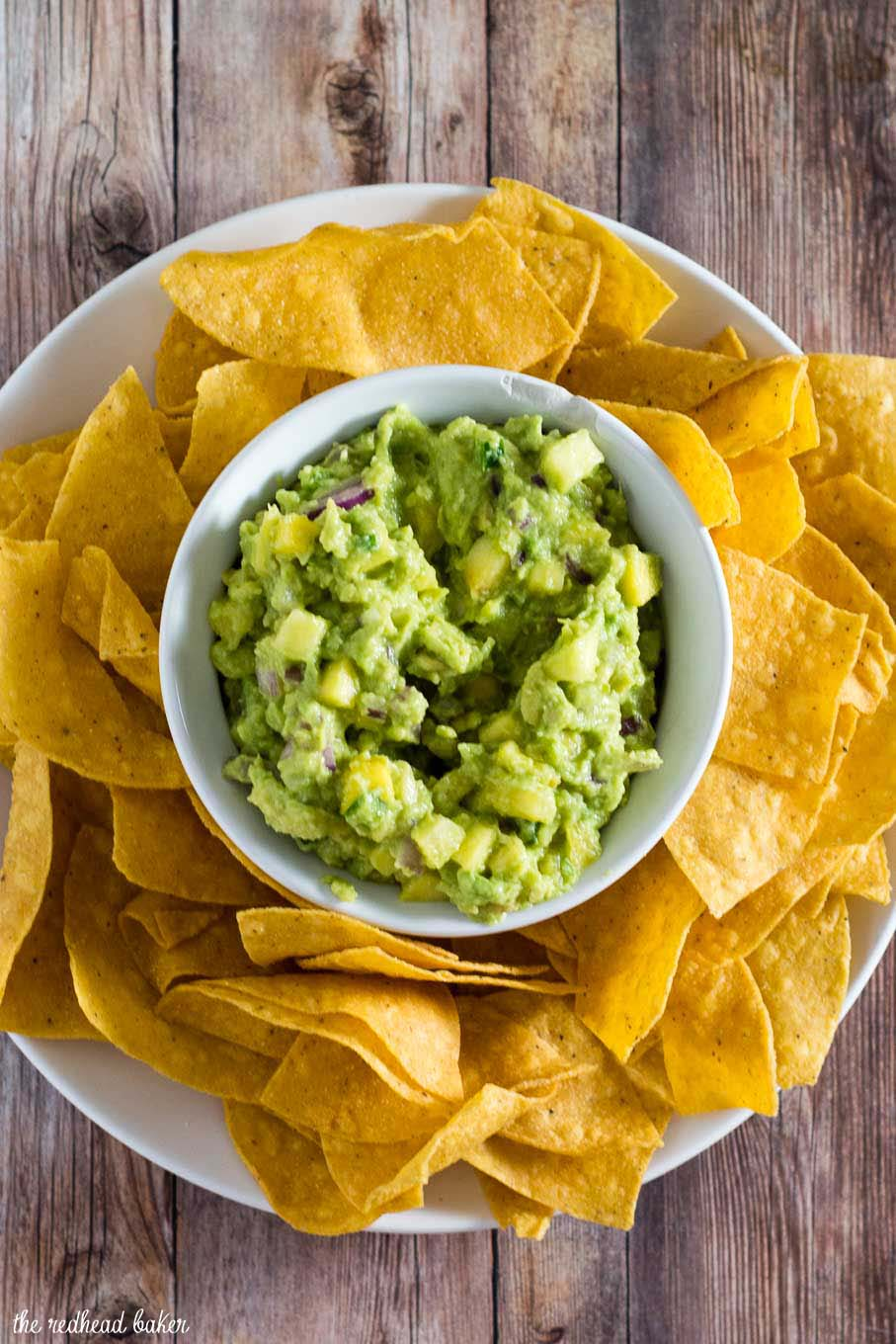 Tropical guacamole puts a sweet spin on a Mexican classic with the addition of pineapple and mango. Serve as a snack, appetizer or side dish!