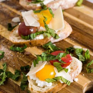 Bruschetta with marinated tomatoes and ricotta is an easy appetizer that epitomizes summer. Using multicolored cherry tomatoes adds visual interest.