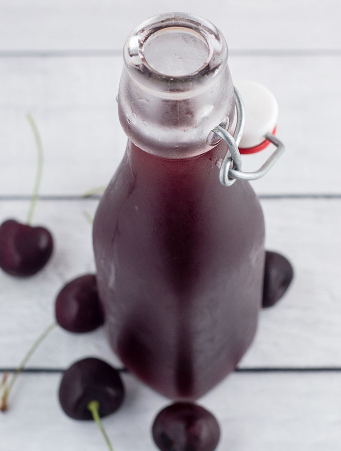 A cherry shrub is a fruit syrup preserved with vinegar, dating back to Colonial America. It can be used to make refreshing cocktails.