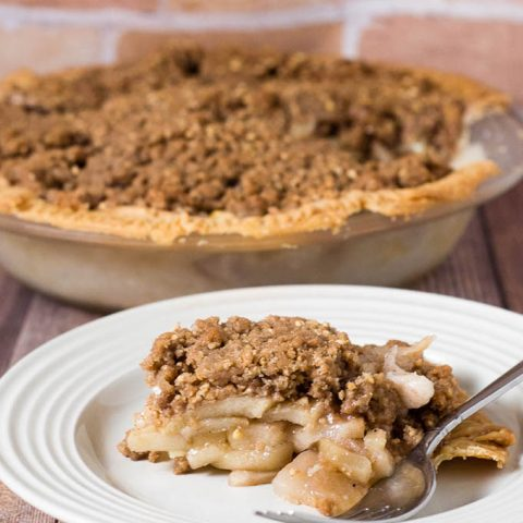Classic apple pie gets a twist with a cinnamon-spiced oat crumb topping that adds texture and flavor. It's the perfect dessert for any fall occasion! #AppleWeek