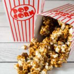 It's so easy to make your own buttery sweet caramel corn at home! This oldie-but-goodie snack will be a hit at any party.