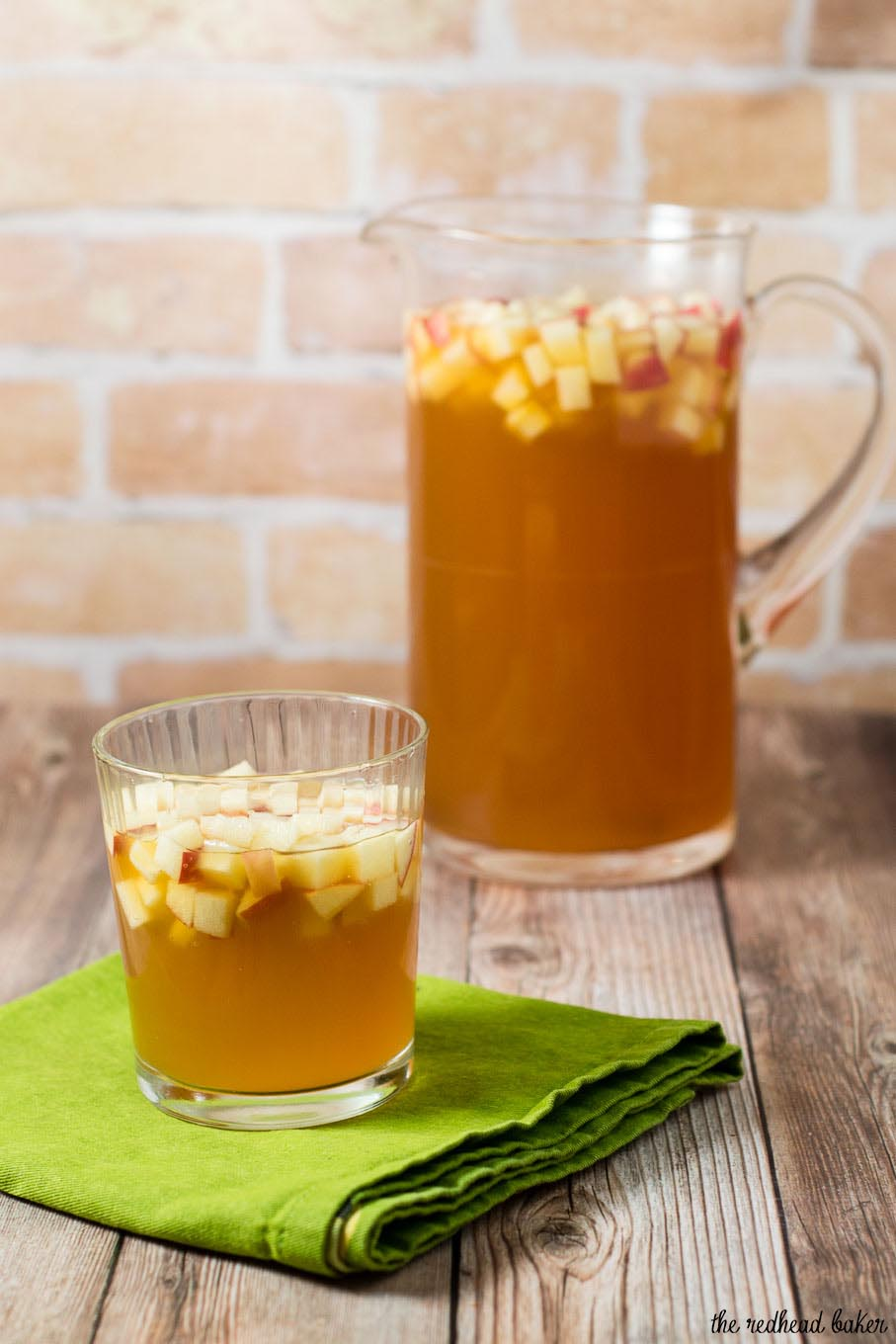 Cinnamon apple cider sangria is a delicious fall cocktail combining white wine, apple cider, apple brandy and cinnamon whiskey. #AppleWeek