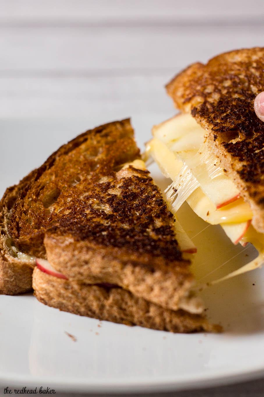 Thinly sliced honeycrisp apples add a sweet twist to classic grilled cheese. They are paired here with gouda, but cheddar would be delicious, too. #AppleWeek