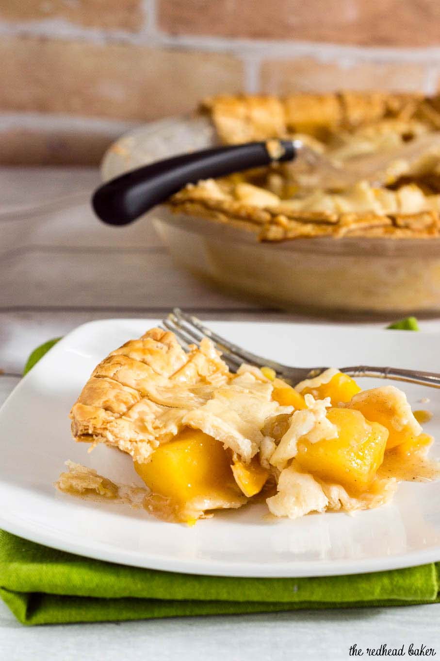 One slice of this mango peach pie is a tropical treat! Chunks of fresh fruit are lightly spiced with cinnamon, ginger and nutmeg.  #OXOGoodCookies #BakeADifference