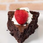Naturally gluten-free flourless chocolate cake is rich, dense, and has intense chocolate flavor. Top with whipped cream, ice cream or fruit sauce. #Choctoberfest