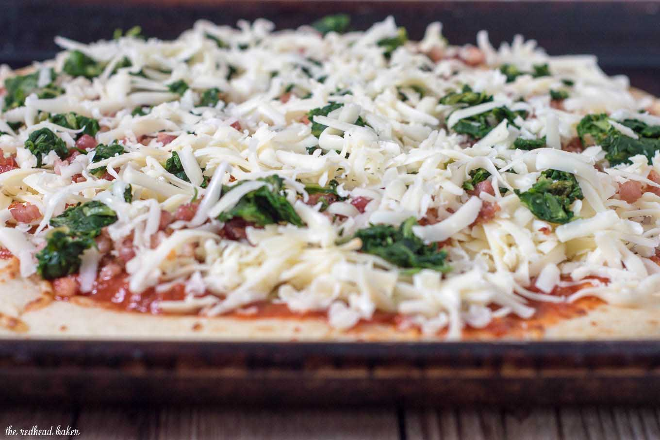 October is National Pizza Month, but this spinach, pancetta and fontina pizza can be enjoyed all year round.