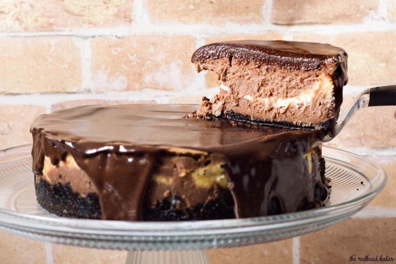 If chocolate cheesecake is good, triple chocolate cheesecake must be better! Layers of semisweet, white and milk chocolate cheesecake on a chocolate cookie crust are topped with a rich chocolate glaze. #Choctoberfest
