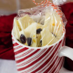 Have a lot of holiday parties to attend? Homemade cranberry-orange bark gives your wallet a break, and provides your hostess with a delicious treat.#FoodGifts