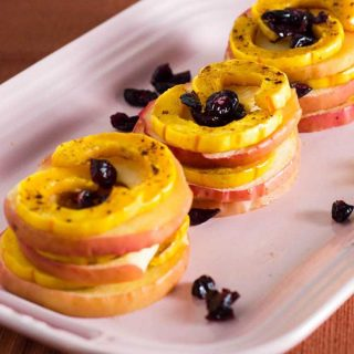 Delicata squash and apple stacks are a unique way to enjoy this fall produce. Seasoned with cinnamon and thyme, they blend sweet and savory flavors.