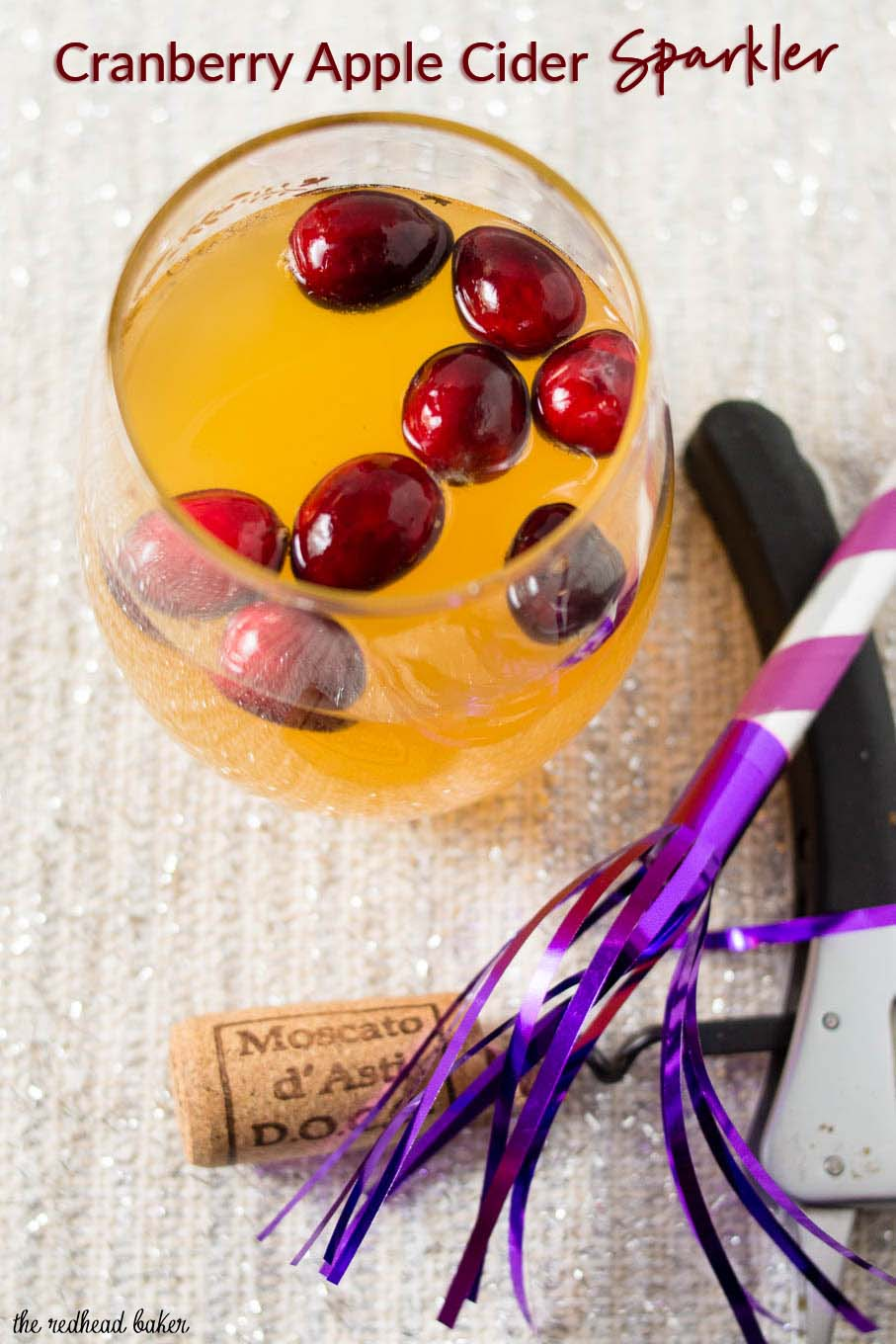 Ring in the new year with this cranberry apple cider sparkler, a cocktail that combine sparkling wine with the winter flavors of apple and cranberry. #CocktailParty