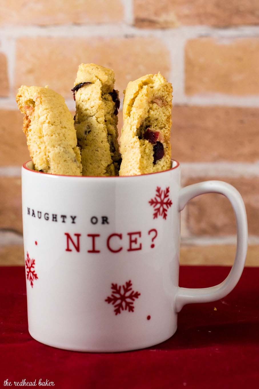 'Tis the season for cranberry eggnog biscotti! These crunchy, sweet cookies are loaded with sweet-tart dried cranberries. #ChristmasCookies