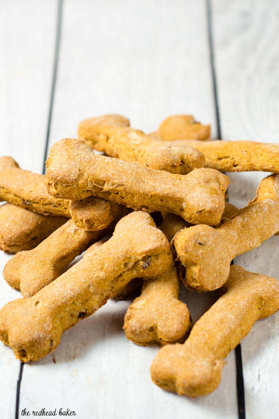 Pumpkin apple dog biscuits are a healthy, crunchy treat for your furry friend. Substitute almond flour for the wheat flour if your dog can't have grains.
