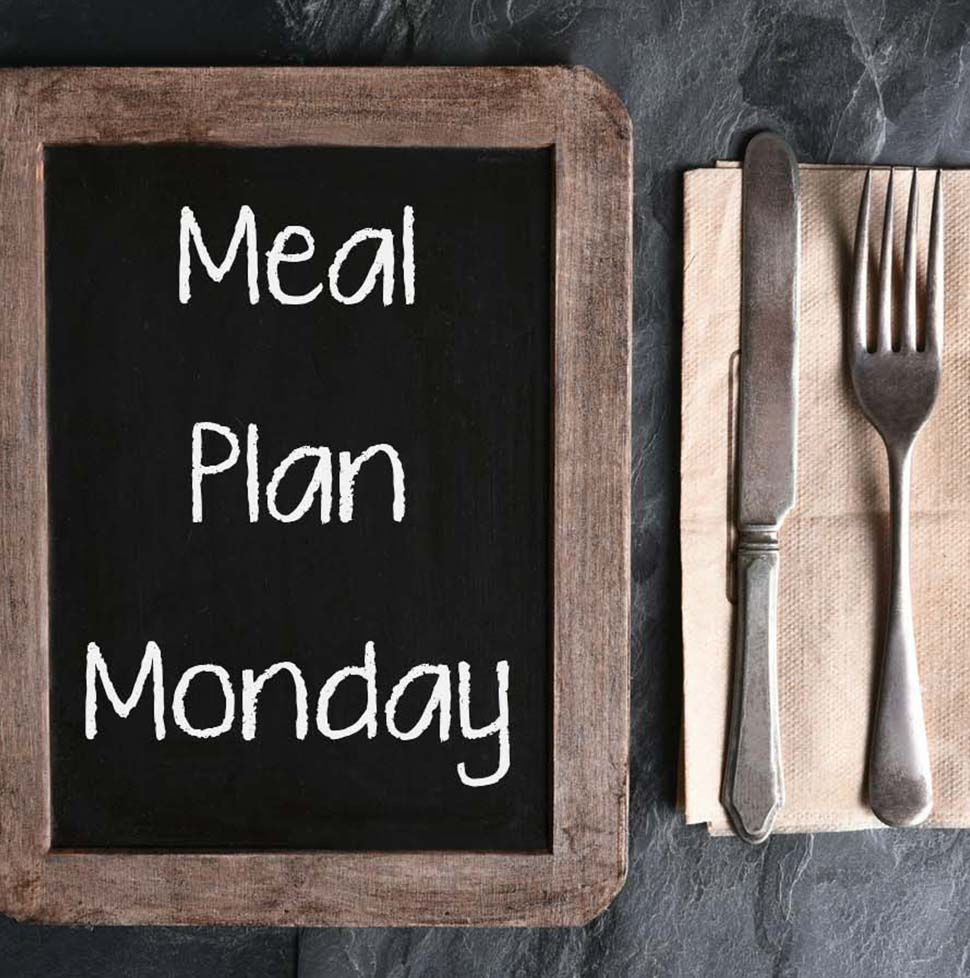 "Chalkboard that says ""Meal Plan Monday"" next to a set of utensils"