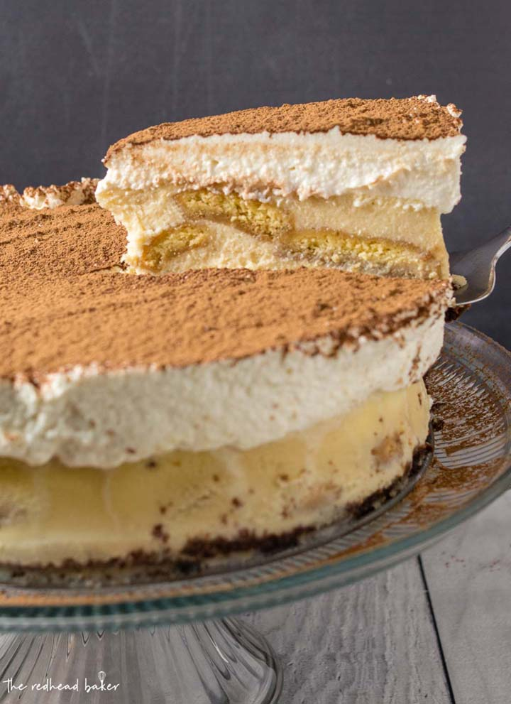 A slice of tiramisu cheesecake being lifted on a cake server.