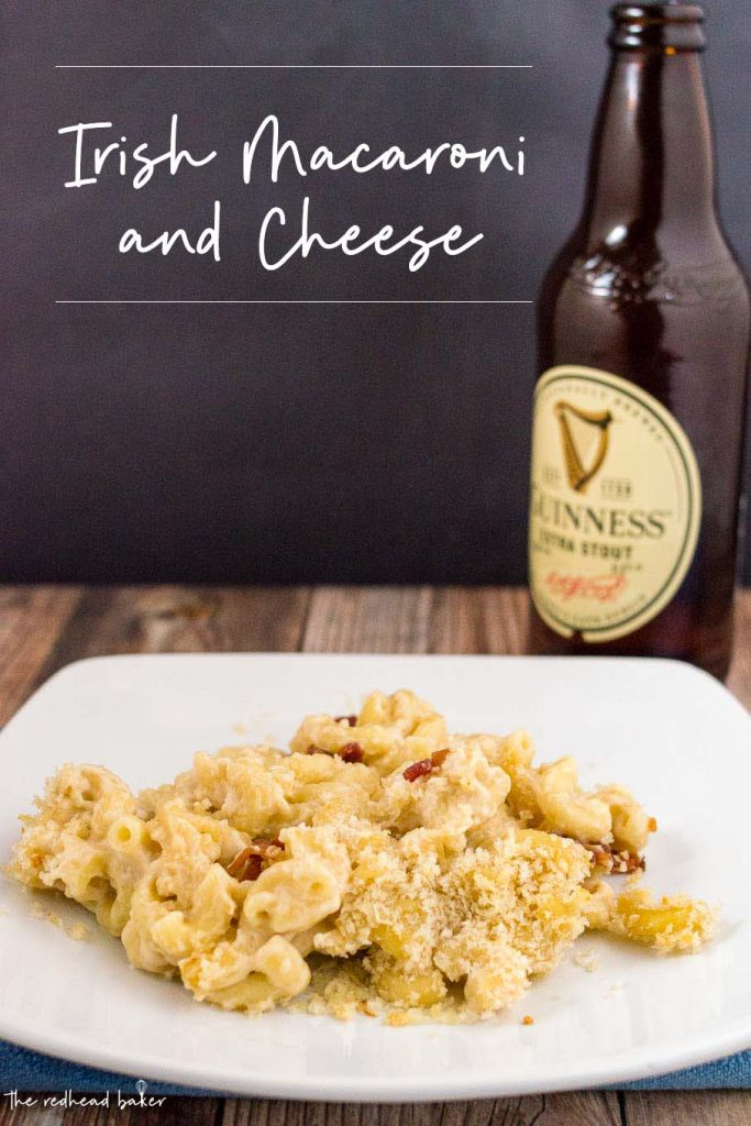 A plateful of Irish mac and cheese with a bottle of Guinness beer behind it.