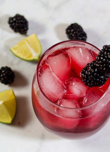 Blackberry lime margaritas have a vibrant color and delicious flavor. Adding lime zest to the simple syrup ensures that the blackberry doesn't overpower the drink's flavor.