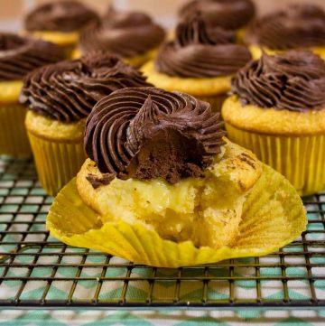 Boston cream cupcakes have all the flavors of Boston Cream Pie in cupcake form: buttery yellow cake, vanilla pastry cream filling, and rich chocolate ganache frosting.