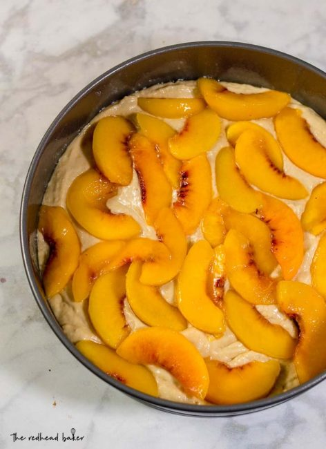 Peach brown butter coffee cake is loaded with peach slices and covered in cinnamon-spiced streusel crumbs. Enjoy it for brunch, dessert, or a snack any time of day!