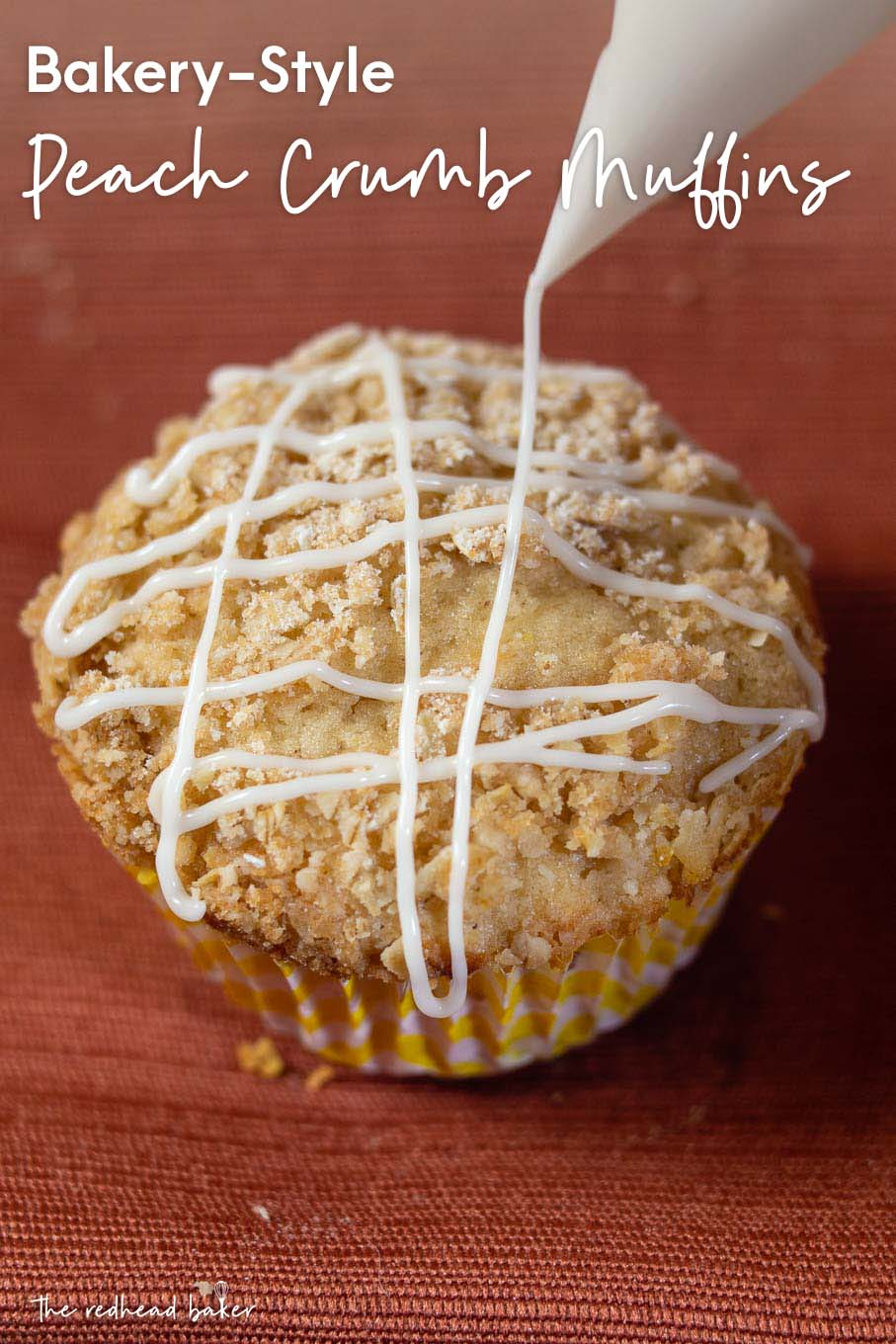 Icing being piped onto a bakery-style peach crumb muffin