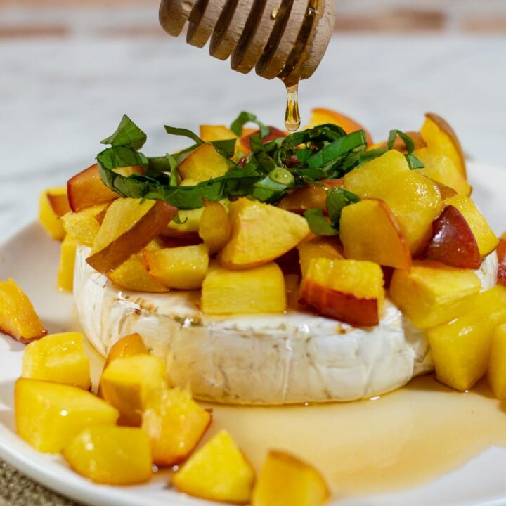 Think baked brie is only for winter holidays? Think again! Honey, basil and peach baked brie uses the freshest flavors of the summer to complement the buttery cheese.