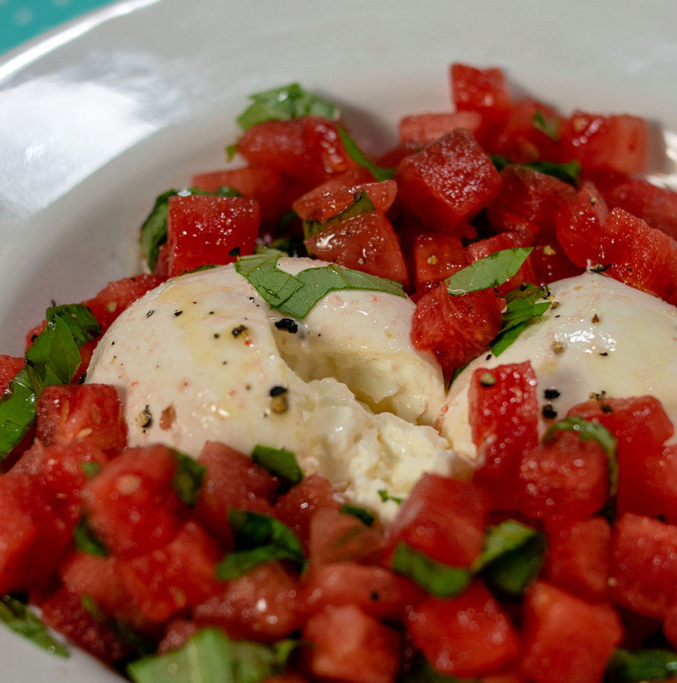 A dish of watermelon burrata salad