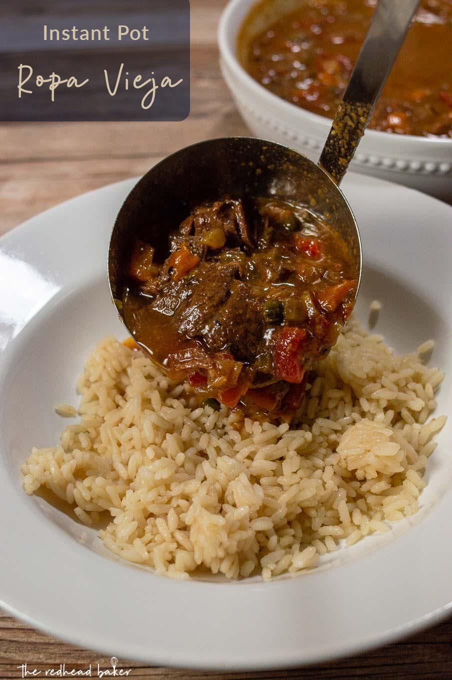 Ropa vieja being ladled on a serving of rice.