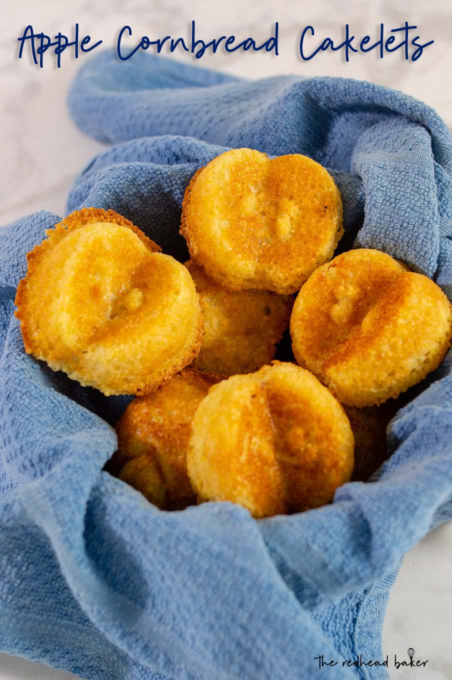 Apple cornbread cakelets in a blue-towel-lined basket