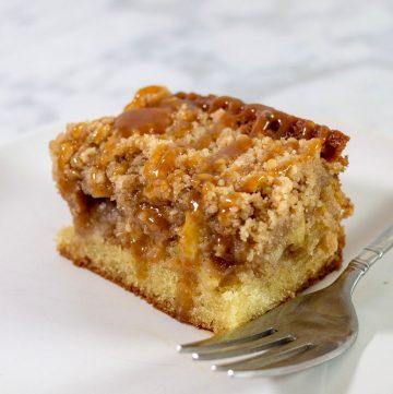 A close-up shot of a slice of caramel apple crumb cake