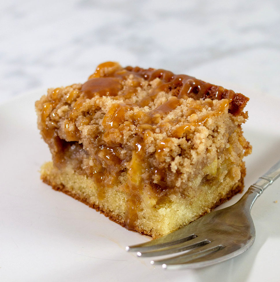 A close-up shot of a slice of caramel apple crumb cake