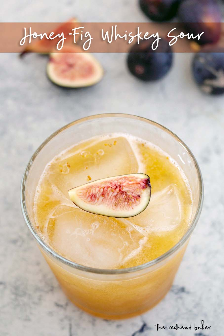 A high-angle photo of a honey-fig whiskey sour, garnished with a quarter of a fresh fig