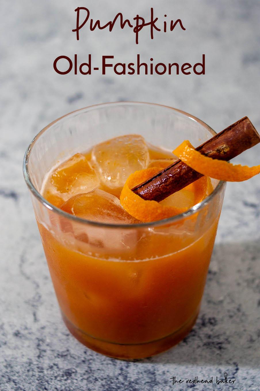 A pumpkin old-fashioned garnished an orange peel twist and a cinnamon stick