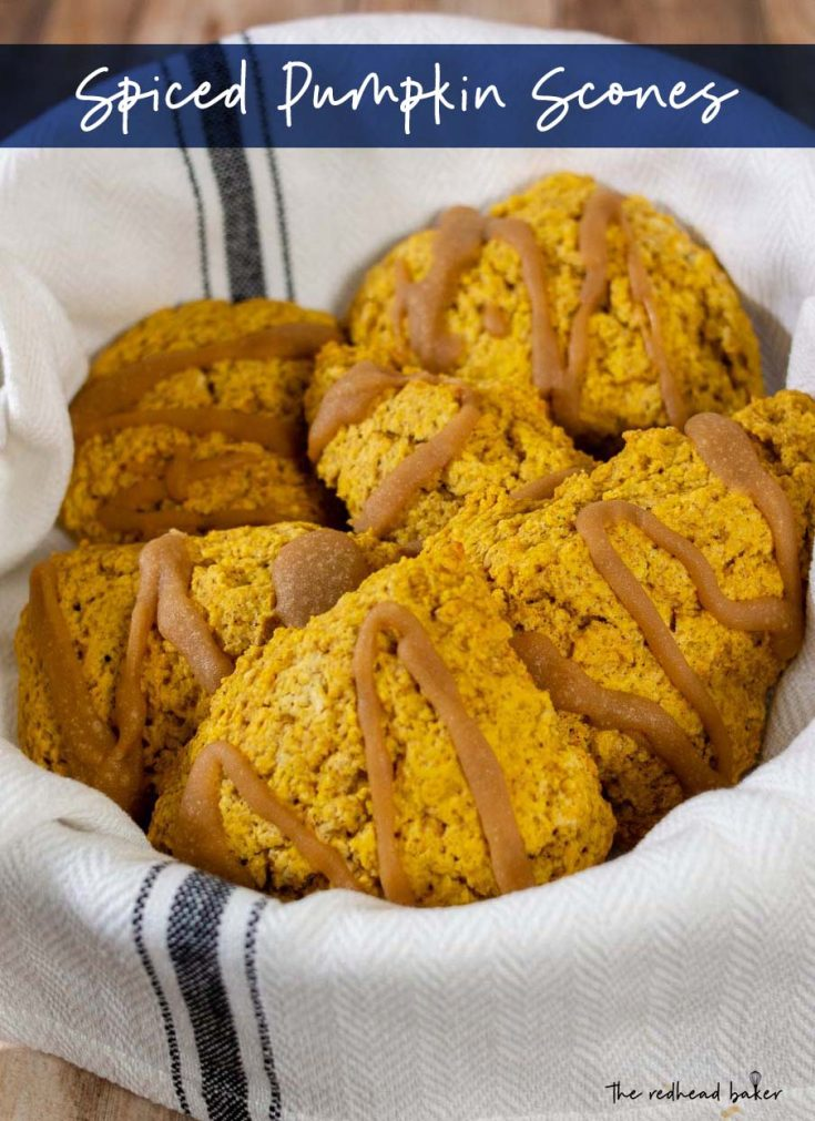 Tender pumpkin scones are a delicious breakfast in a chilly autumn morning. A glaze of caramel adds a touch of sweetness.