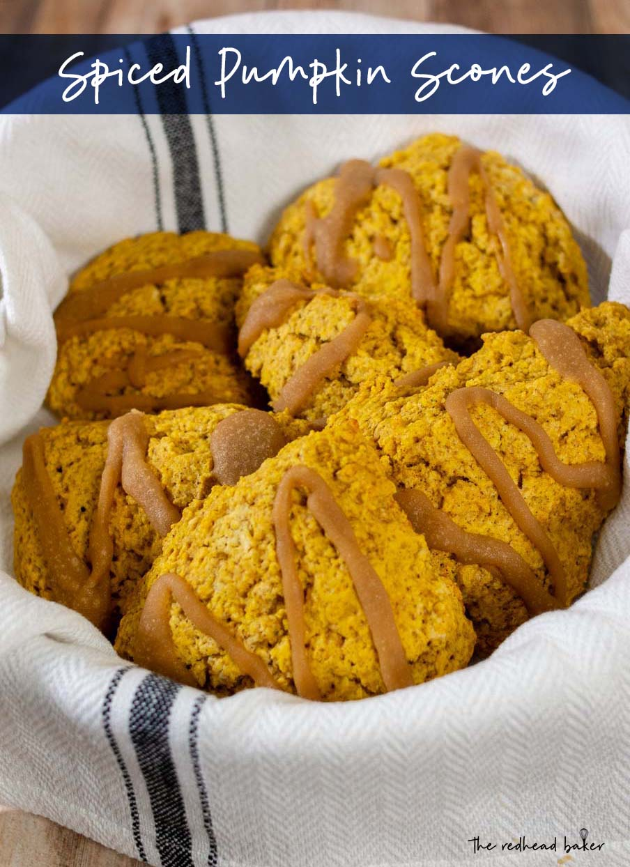 A white towel-lined basket holds a batch of spiced pumpkin scones.