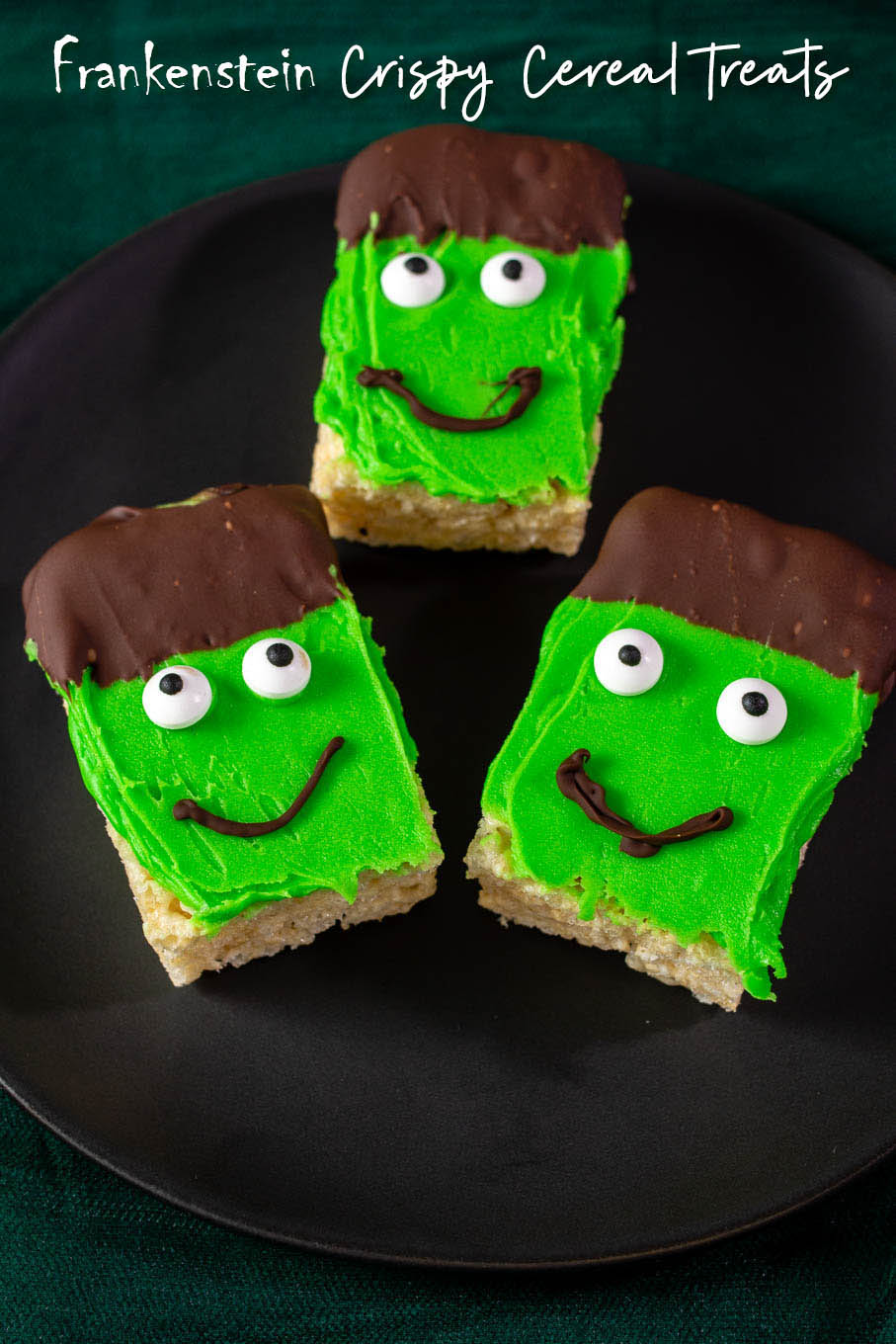 Three Frankenstein Crispy Rice Cereal Treats on a black plate