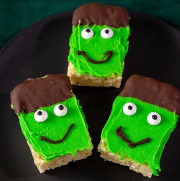 Three Frankenstein Crispy Cereal Treats on a black plate