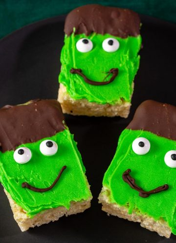 Three Frankenstein Crispy Cereal Treats on a black plate