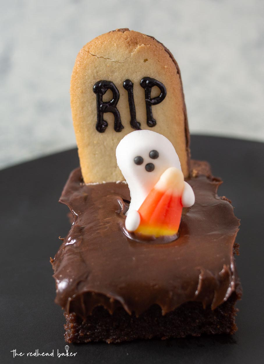 A single haunted graveyard brownie on a black plate
